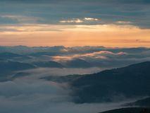Landscape of mountains, clouds and sun going west. Carpathians mountains in august, west Ukraine. Nature background. Sun. Illuminating white clouds in the stock images