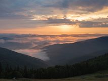 Landscape of mountains in the evening. Background of Carpathians mountains in august, west Ukraine. The sun going west. And illuminating the clouds. Ukrainian stock photography