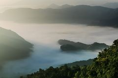 Landscape, mountains and fog in the morning when the sunrises in the background. Royalty Free Stock Image