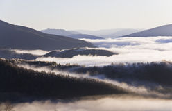 Landscape with mountains, forest and mist. Morning mist in the mountains Royalty Free Stock Photography