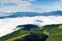 Landscape with mountains and forests under clouds Stock Image