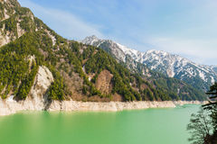 Landscape of mountains with green lake at Kurobe dam. Stock Photo