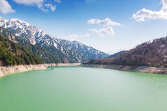 Landscape of mountains with green lake at Kurobe dam. Stock Image