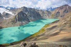 Beautiful mountain lake. Landscape in mountains of Kyrgyzstan Stock Photos