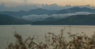 Landscape. Mountains and lake in mist on morning with light blue Royalty Free Stock Photos