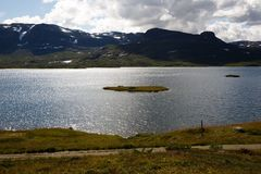 Landscape in Norway. Landscape with mountains, lake, sky and clouds in Norway Royalty Free Stock Photos