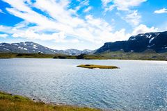 Landscape in Norway. Landscape with mountains, lake, sky and clouds in Norway Stock Image
