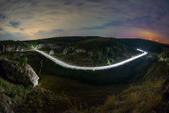 Landscape of mountains with light trails of car on road, Dobrogea Royalty Free Stock Photography