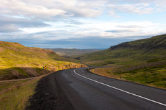 Landscape with mountains and meandering road at sunset, Iceland Royalty Free Stock Image