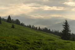 Picturesque mountain landscape. Mid-morning in polish beskid mountains, shot during rays of light stock photos