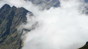 Landscape of mountains and mist. Hyper Lapse. Panoramic view of the Pyrenees of Andorra with the fast movement of fog.Smooth camera movement: Panning Right + stock footage