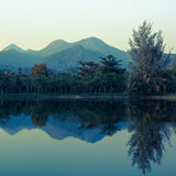 Landscape of mountains reflected in the lake. Stock Photos
