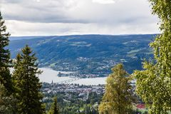 Landscape in Norway. Landscape with mountains, river and buildings in Lillehammer town, Norway Stock Images
