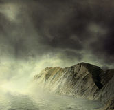 Landscape.  Mountains and sea in mist Royalty Free Stock Photography