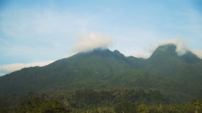 Landscape of mountains and sky.Camiguin island. Mountains landscape, rainforest, jungle, blue sky, clouds and mist. Volcano on the island of Camiguin. Travel stock video footage