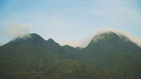 Landscape of mountains and sky. Camiguin island. Mountains landscape, rainforest, jungle, blue sky, clouds and mist. Volcano on the island of Camiguin. Travel stock video