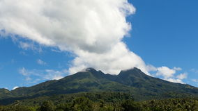 Landscape of mountains and sky.Timelaps. View from the mountains to the jungle.Tropical Mountain.Volcano on the island of Camiguin.Timelaps.Mountain landscape in stock video footage