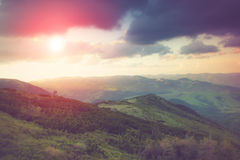 Landscape in the mountains spring valleys at sunlight. Royalty Free Stock Photo