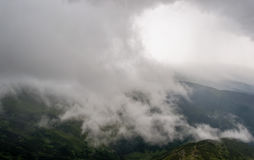 Landscape in mountains with trees and clouds. More available royalty free stock photography