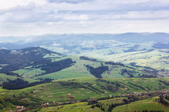 Landscape of  mountains with trees and grassy valley Stock Photo