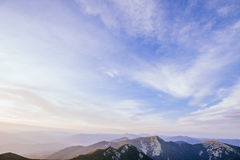 The landscape of mountains under sky with clouds Stock Photo
