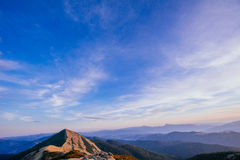 The landscape of mountains under sky with clouds Royalty Free Stock Photo