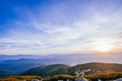 The landscape of mountains under sky with clouds Stock Image
