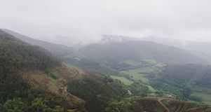 Mountainous landscape with mists. Landscape with mountains and villages covered in light fog Stock Photography
