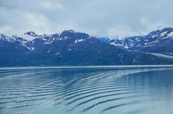 Landscape Of Mountains And Water  In Alaska. Majestic landscape of mountains and water in Alaska as seen from the cruise liner Royalty Free Stock Images