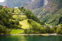 Landscape in Norway. Landscape with Naeroyfjord, mountains and traditional village houses in Norway Stock Images
