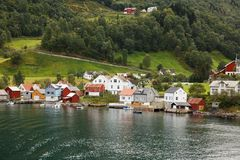 Village in Norway. Landscape with Naeroyfjord, mountains and traditional village houses in Norway Stock Photo