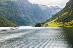 Landscape in Norway. Landscape with Naeroyfjord, mountains and traditional village in Norway Royalty Free Stock Images