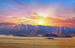 Landscape of Namib Naukluft National park at sunrise in Namibia. Namib Naukluft Desert panorama view with mountains and desert sand with a dramatic sunrise Royalty Free Stock Images