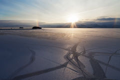 Landscape with natural drawing on snowed icefield and solar halo Royalty Free Stock Photos