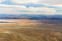 Aerial view of grand canyon desert and lake mead. Landscape and nature concept - aerial view of grand canyon desert and lake mead from helicopter stock photo