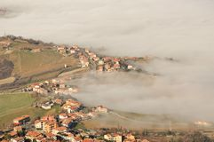 Landscape of nature in the fog of San Marino country in Italy Royalty Free Stock Photography