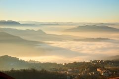Landscape of nature in the fog of San Marino country in Italy Royalty Free Stock Photo