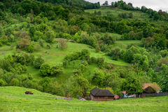 Landscape Nature in Romania. Mountain and Cloudy Sky. Lonely House in Nature. Royalty Free Stock Photography