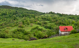 Landscape Nature in Romania. Mountain and Cloudy Sky. Lonely House with Red Roof Stock Photography