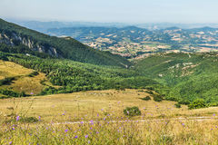 Landscape near Fabriano. Italy. Panoramic view of beautiful tuscan landscape, golden harvest fields, green wine gardens, Umbria, Italy Royalty Free Stock Photo