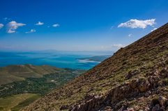 Landscape of the near mountain lake, village, lake and cloudy sky background. From Van, Turkey royalty free stock image
