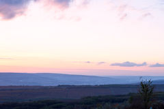 Landscape of Negresti village at purple sunset in Moldova Stock Images