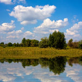 Landscape with nice clouds over lake Stock Photography