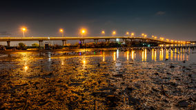 Landscape of night bridge with mire in river Royalty Free Stock Photography
