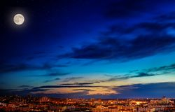 Landscape of the night city, moon and stars in the  sky stock photos