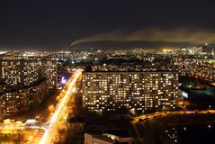 Landscape of a night city with a smoke from a pipe Stock Photos