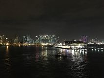 Landscape night view from sea of marina financial and MBS Singapore. And Stock Images