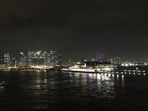 Landscape night view from sea of marina financial and MBS Singapore. And Stock Photography
