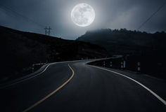 Landscape of nighttime with curvy roadway in forest at national. Landscape of full moon with curvy roadway in forest at national park. Mountain winding road stock photography