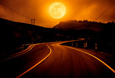 Landscape of nighttime with curvy roadway in forest at national. Landscape of full moon with curvy roadway in forest at national park. Outdoors at night on stock photos